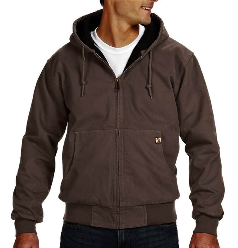 A man has worn dark brown hoodie jacket with white t-shirt inside